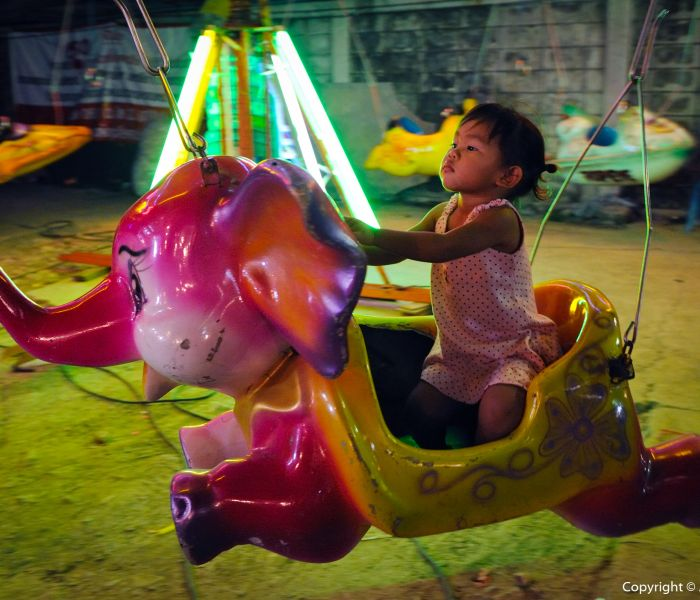 Driving the Elephant at a Funfair in Bangkok